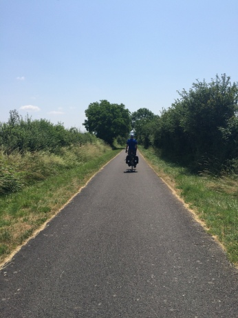 Adam bicycling through the sun